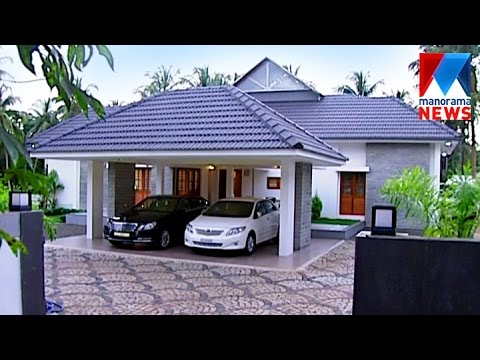 Thuruthiparambil kerala and roman style house 3500 sq for Low cost kerala veedu plans