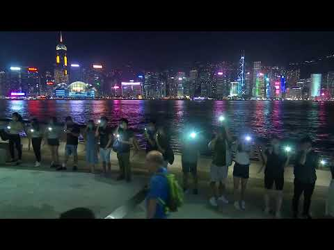 Protesters form a human chain spanning Hong Kong Island