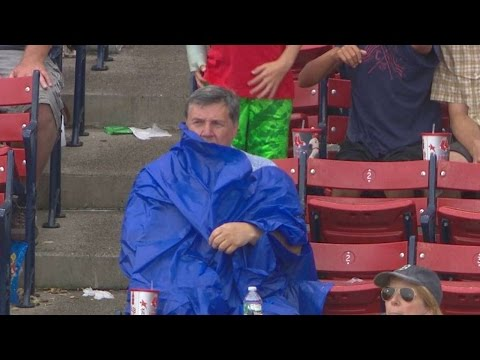 Fan struggles to put on poncho at Fenway Park