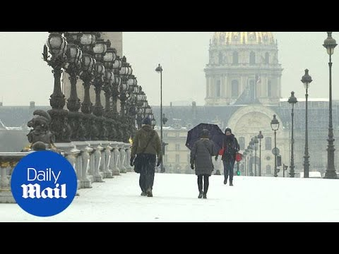 Stunning footage of Paris as first winter snow hits French capital