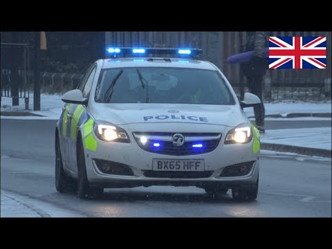 West Midlands Police car responding in the snow