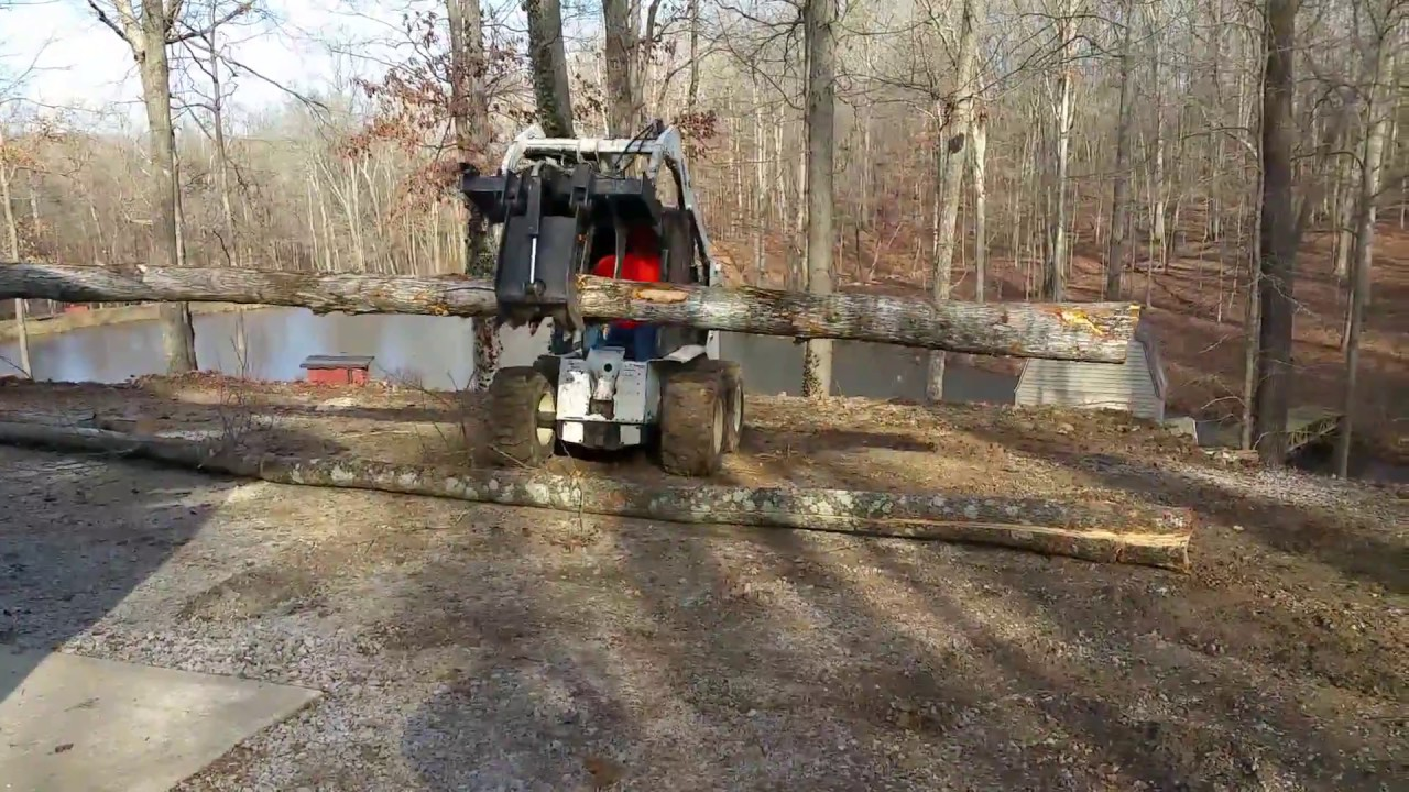 Building 2 rustic retaining walls out of tree logs - YouTube