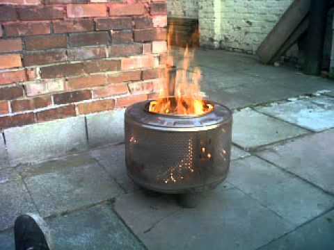 outside wood fire bin made from a washing machine drum