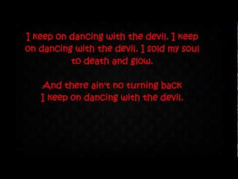 Ke$ha - Dancing With The Devil [LYRICS]