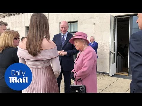 Queen Elizabeth meets a robot on visit with Kate at King's College