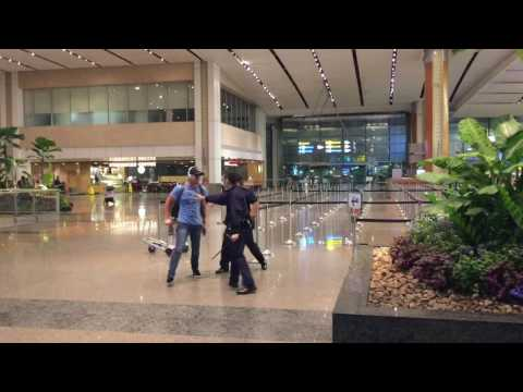 Thumbnail: Aussie bogan fights police officers at Singapore Changi Airport