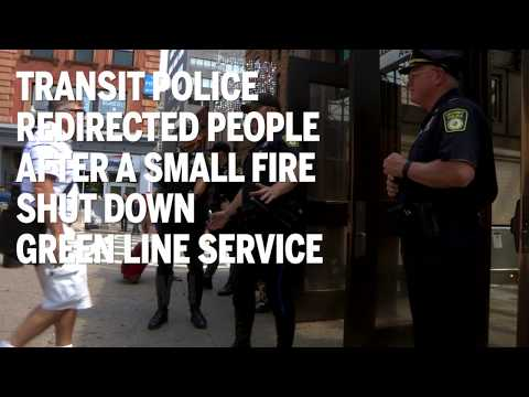 Transit police redirected people after a small fire shut down Green Line service downtown