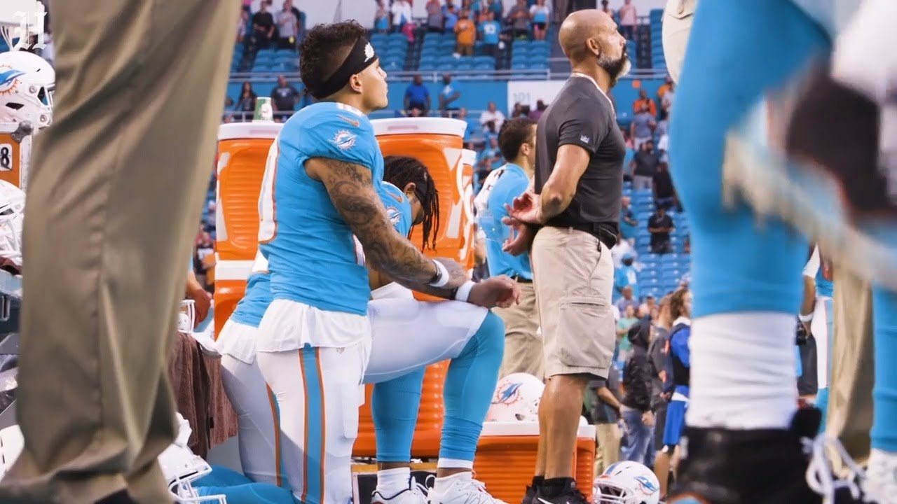 The Latest: Miami's Stills, Wilson kneel during anthem