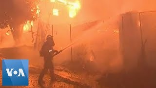 Firefighters Battle Wildfires in Los Angeles