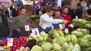 داود اوغلو يبيع الخضار فى سوق الاربعاء باسطنبول