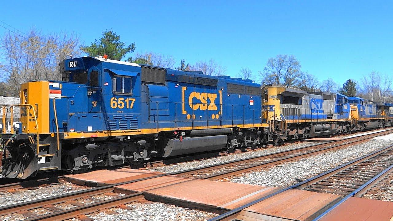 Emd gp40 3 locomotive on csx q370 mixed freight train