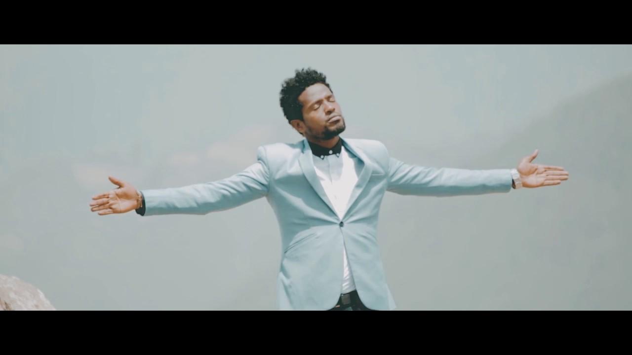 "Download Mulualem Ayele ""Kiber Yitayegnal"" ክብር ይታየኛል New Amharic Protestant MEzmur 2018(Official Video)"