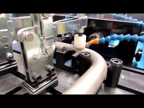 Двухголовный автоматический станок для сверления труб
