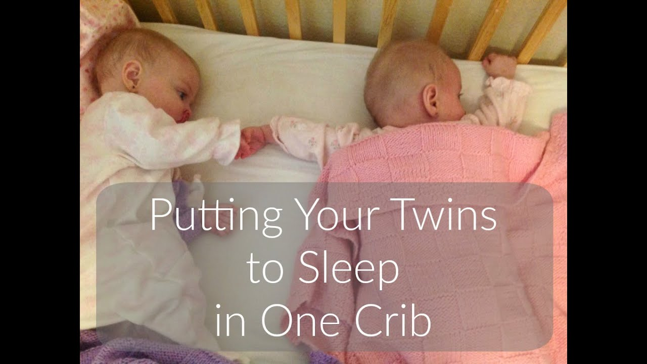 Putting twins to sleep in the same crib