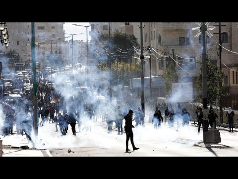 Israeli troops clash with Palestinian protesters in West Bank over Jerusalem decision