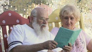 Old People Read Book in Rocking Chairs, the Husband Kiss a Wife in a Cheek | Stock Footage -