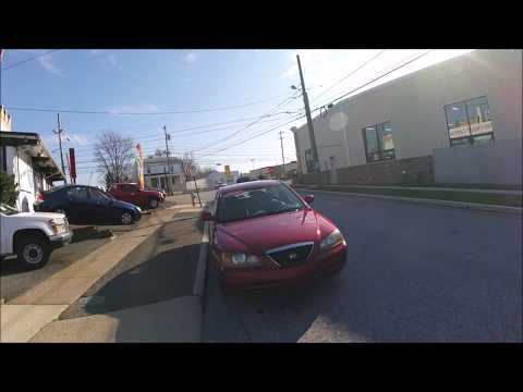 2004 Red /Gray Hyundai Elantra GLS (KMHDN46D04U) with an 2.0L L4 DOHC 16V engine, Automatic transmission, located at 577 Chester Pike, Prospect Park, PA, 19076, (610) 237-1015, 39.886154, -75.302338 - Photo #0