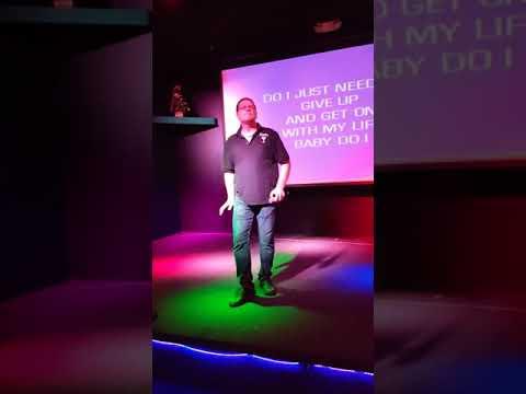 Goadie Locks singing karaoke at Louie's