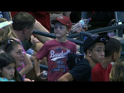 Kid misses ball, another gives him souvenir