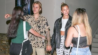 EXCLUSIVE - Hailey Baldwin Stands By As Justin Bieber Hugs Female Fans On Date Night