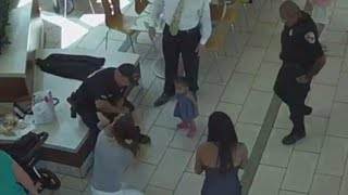 Surveillance video shows 2 officers saving choking baby