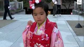 Kimono wearing children and mother at Suiten-gu Shrine in Eastern Tokyo Japan
