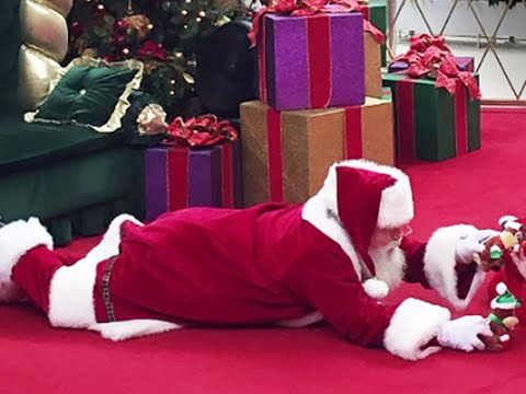Santa lays down on floor for autistic boy
