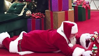 Santa lays down on floor for autistic boy