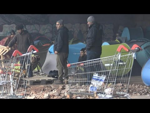 Migrants holed up in camp in northern France determined to reach UK | AFP