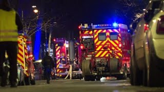 Emergency services arrive after deadly Paris fire