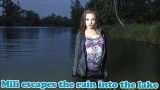 Wetlook - Mili escapes the rain into the lake