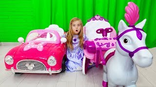 Ulya rides on pink car and plays with dolls