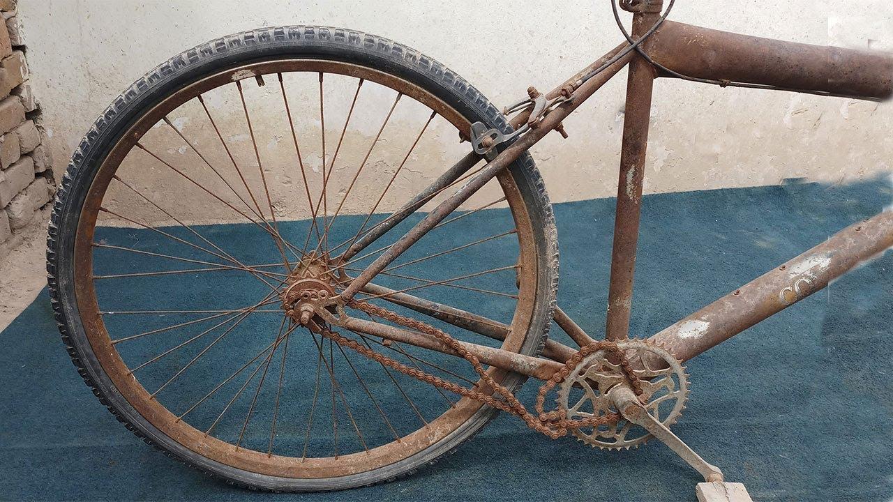 RESTORATION - A Villager Restoring Old Bicycle Wheel For ...