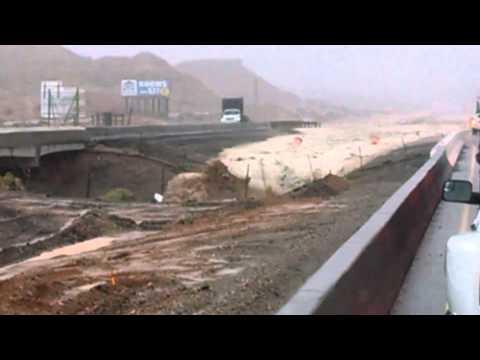 Caught on tape: minivan washed off I-15 near Las Vegas