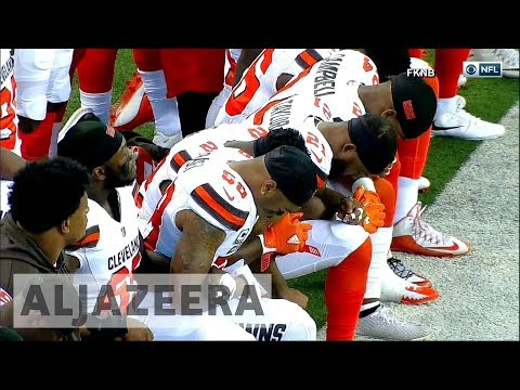 Download Youtube: Trump's sports row: NFL players react across US