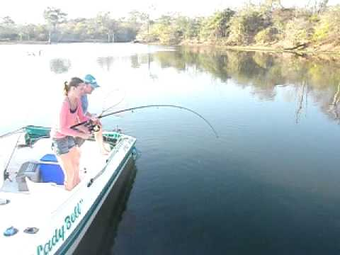 Serina catching a Maramba in Kariba