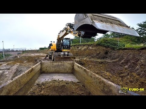 Liebherr A918 Excavator Digging Clay And Loading Tatra Terrno1 Tipper Truck