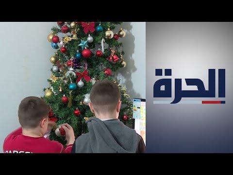 في الأردن.. حزن يصاحب احتفال المسيحيين العراقيين اللاجئين بعيد الميلاد