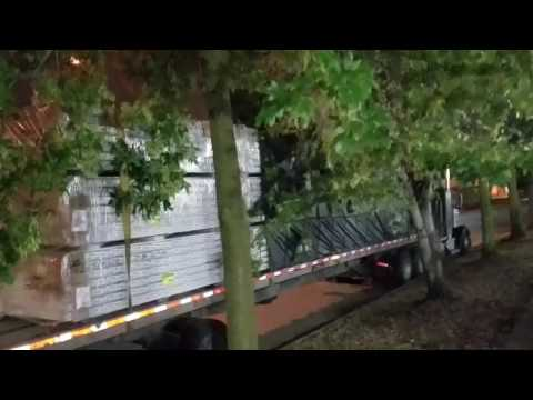 Thee She Beast Flatbed heavy tarp job! Behind the screen of