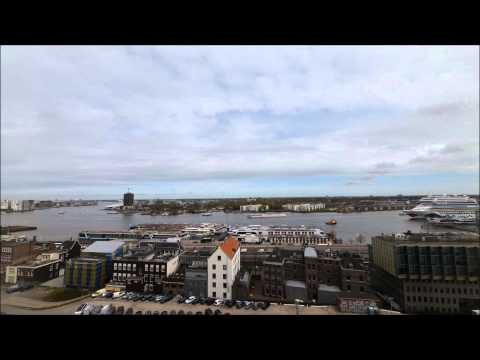 Amsterdam timelapse with cruise ship coming in