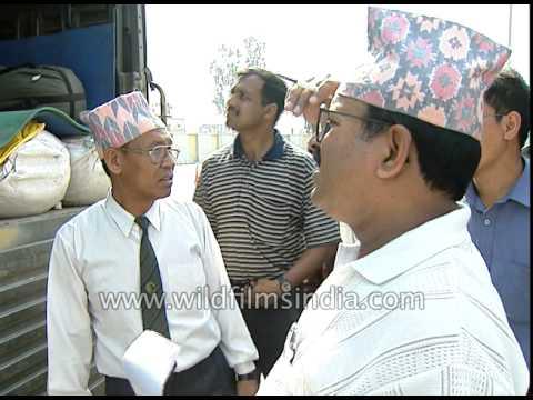 Nepal customs officers check Indian trucks at India-Nepal Border