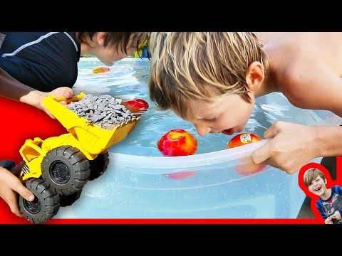 Toy Construction Trucks Clean Up + Bobbing For Apples!