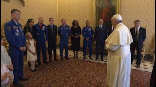 Astronauts prepare Pope Francis for space