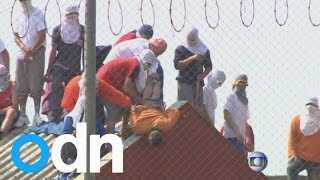 Brazilian prisoners dangle hostage from roof in prison conditions riot
