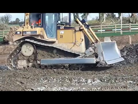 CAT D6 Dozer At Work Levelling Stone On A Road Construction Site #1