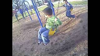baby freaks out on the swings at the park!!...HILARIOUS