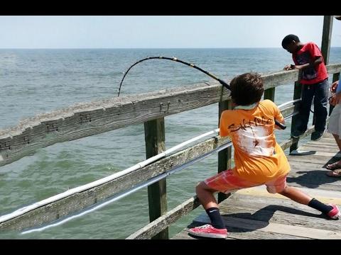Boy catch fish 6 year catches huge fish fishingnet for Watch big fish