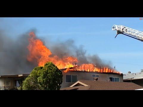 Firefighters Hose Down Intense Windy House Fire HD