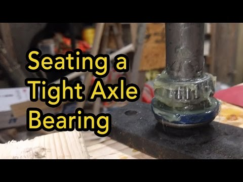 Seating Axle Bearing on Woods Finish Mower - YouTube