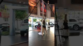 Vaudeville aerialist at Porsche Dealership in Los Angeles, California June 2019
